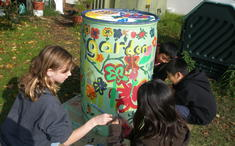 Kid-designed and painted rain barrels!